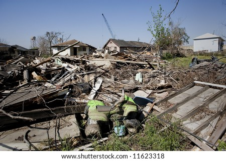 Heavily damaged homes in the Ninth Ward of New Orleans. One block behind these homes is the industrial canal that collapsed during the storm surge of hurricane Katrina. - stock photo