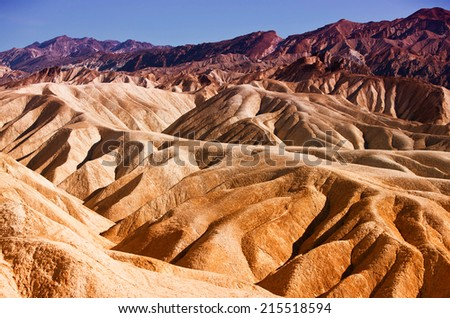 Heavily Eroded Ridges At the famous Zabriskie Point, Death Valley National Park, California, USA - stock photo
