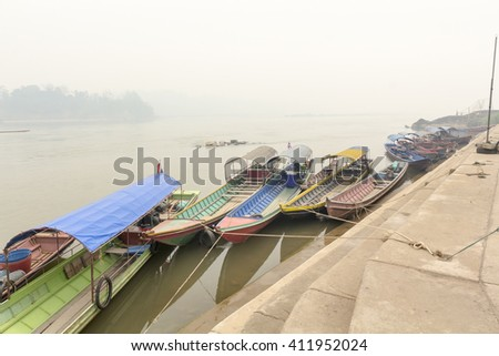 Heavily polluted air from forest fire cover Mekong river at chiang khong port, Chiang rai ,Thailand. - stock photo