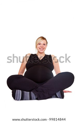 Heavily pregnant women at the gym - stock photo