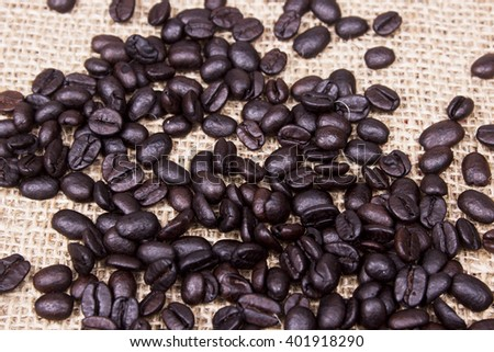 heavily roasted coffee beans,Coffee beans on a burlap.