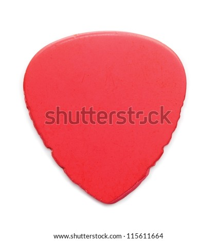 heavily worn and used Red guitar pick, isolated on white. Sides have notches from heavy string abrasion. - stock photo