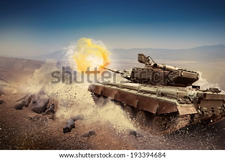 Heavy armor in the field of battle - stock photo