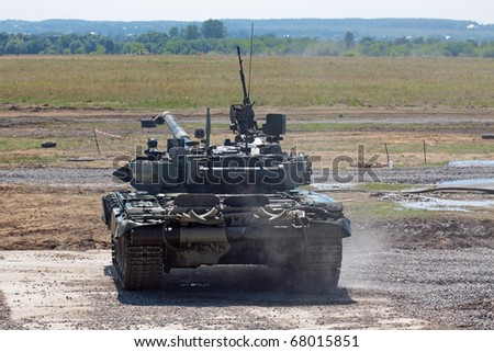 Heavy armor in the field of battle, the rear view - stock photo