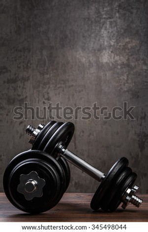 Heavy black dumbbells for workout - stock photo