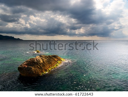 Heavy clouds on sea. Nature composition. - stock photo