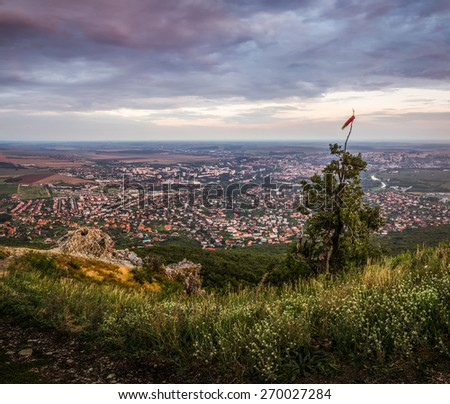 Heavy Clouds over the City of Nitra as Seen from Hill at Sunset - stock photo