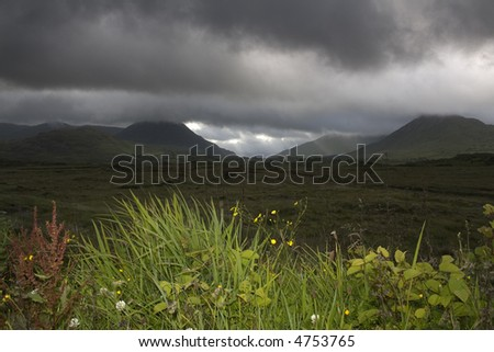 heavy clouds over the irish western moors and mountains - stock photo