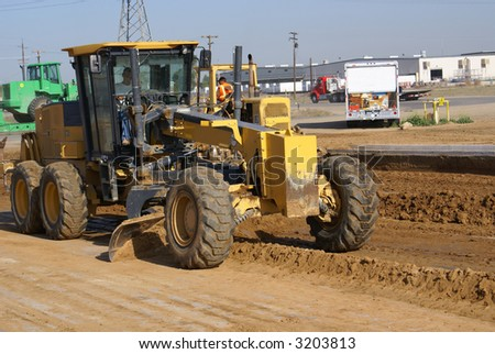 Heavy construction equipment working to widen a roadway - stock photo