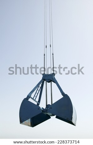 Heavy duty bucket of the dredging platform - stock photo