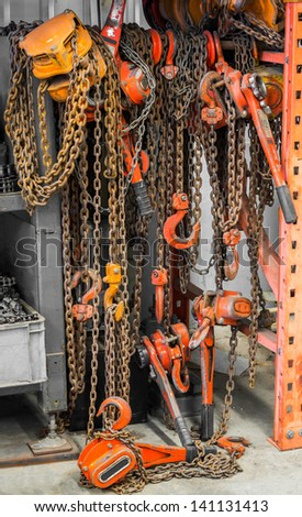 Heavy duty chain hooks and reels in warehouse