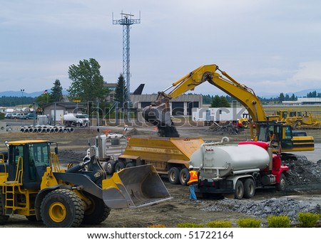 Heavy Duty construction equipment at work site - stock photo