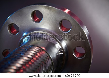 Heavy Duty High Pressure Hose on Stainless Steel Background - stock photo