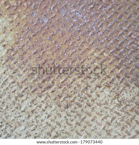 heavy duty rusty metal background with non slip repetitive patten. Concept image for urbanization, steampunk, construction, safety at work, oxidation - stock photo