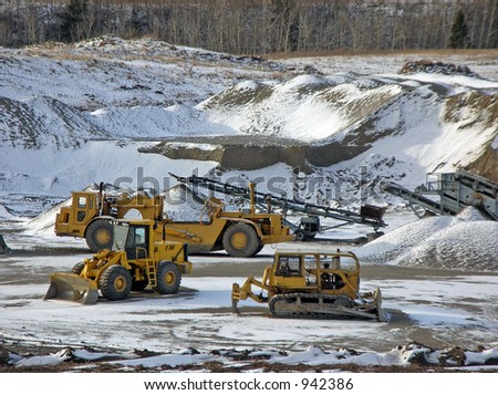 heavy equipment in a gravel pit - stock photo