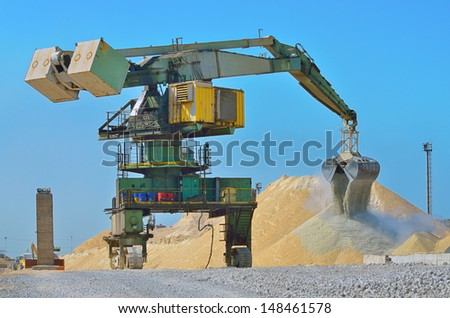 Heavy excavator loader at soil moving works at construction  - stock photo
