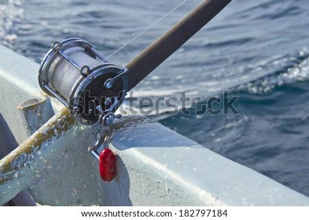 heavy fishing reel on the shipboard - stock photo