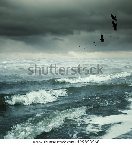 heavy gale, selective focus on nearest wave - stock photo