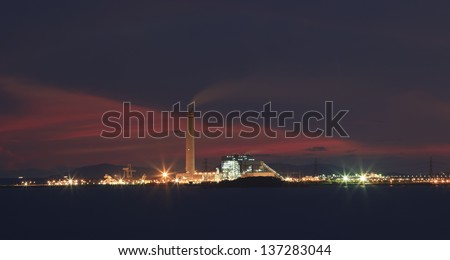 heavy industry in industrial estate and beautiful dramatic sky twilight of a day use for industry and green environment - stock photo
