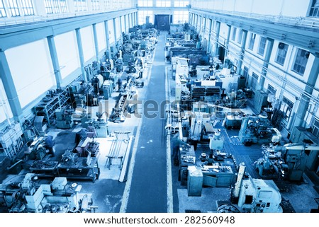 Heavy industry workshop, factory. CNC, boring, threading, drilling machines. Aerial, top view. Blue tone - stock photo