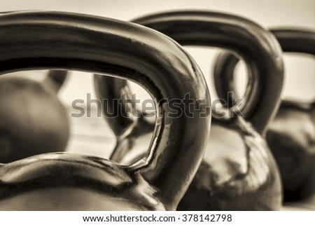 heavy iron kettlebells - black and white abstract with a shallow depth of field - fitness concept