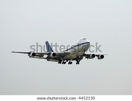 Heavy jumbo jet landing - stock photo