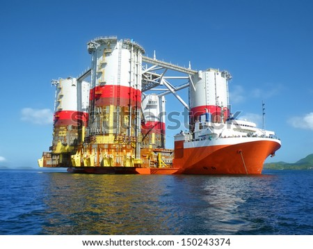 Heavy lift cargo ship transporting an oil rig
