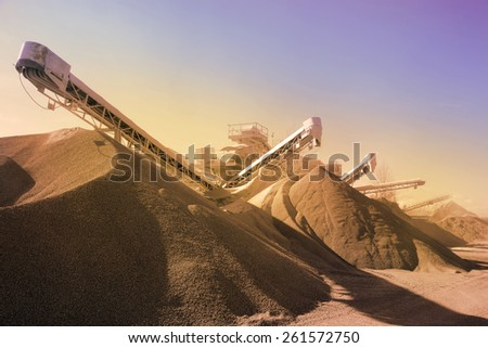 Heavy machinery of gravel production in quarry. Vintage retro effect - stock photo