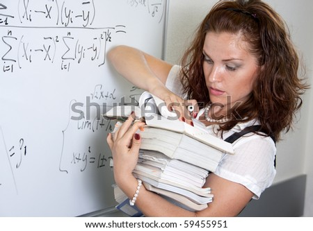Heavy mathematics science. Student with heap of books - stock photo