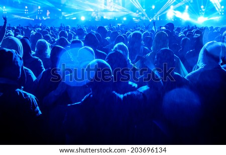 Heavy metal concert audience enjoying music in the rain. - stock photo