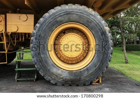 Heavy mining truck, big wheel - stock photo