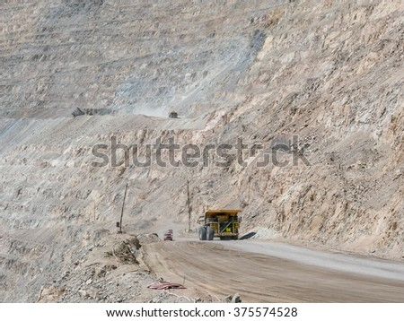 Heavy mining truck in mine and driving along  - stock photo
