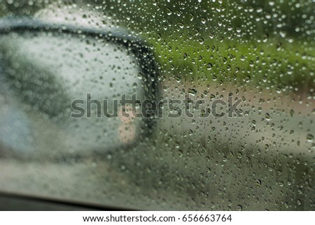 Heavy rain, blurry auto glass. traffic jam
