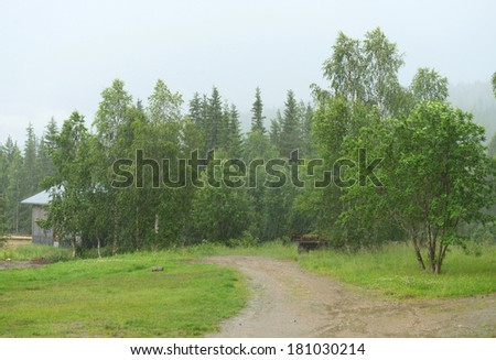 Heavy rain in countryside  - stock photo