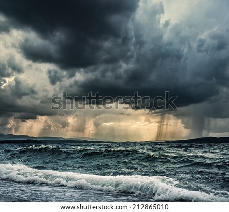 Heavy rain over stormy ocean - stock photo