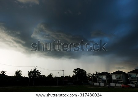 heavy rain storm clouds, thunderstorm dramatic sky, bad day weather background - stock photo