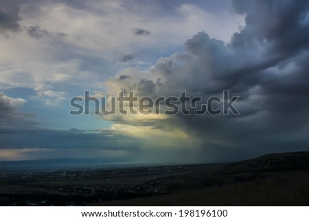 Heavy rainy clouds over the city. Panorama view  - stock photo