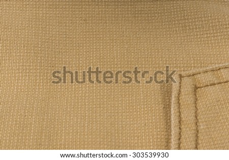 Heavy sand-colored fabric close up. Textile background