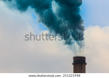 Heavy smoke and coal powered plant stacks - stock photo