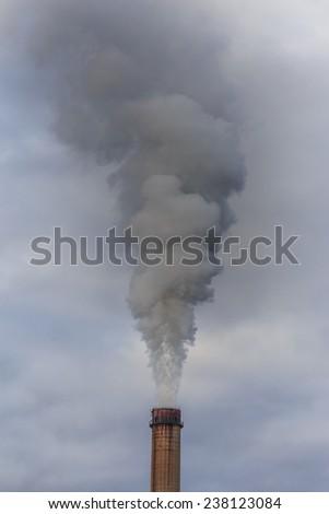Heavy smoke from coal powered plant - stock photo