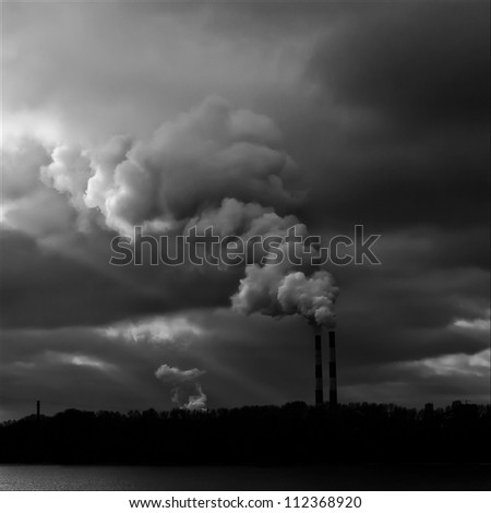 Heavy smoke from industrial chimney polluting the environment - stock photo