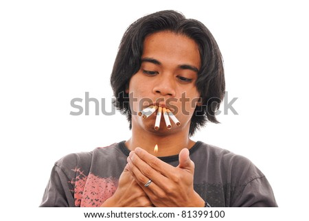 Heavy Smoker Lighting 5 Cigarettes At Once