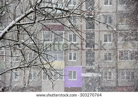 Heavy snowfall opposite windows of residential house. Shallow depth of field - stock photo