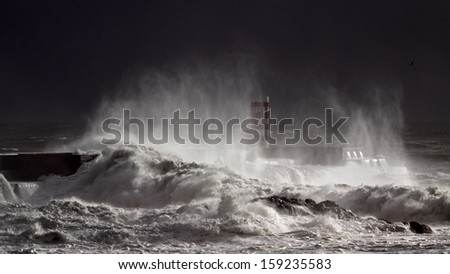 Heavy storm at the entrance of the river Douro harbor. The light is coming from a momentary sunbeam.