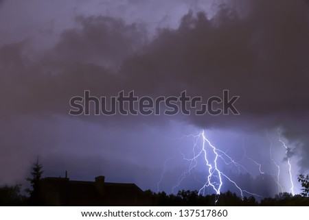 Heavy storm, lighting over the city.
