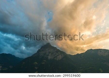 Heavy terrible storm clouds over the mountain peaks.