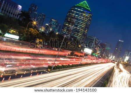 Heavy traffic captured with long exposure in Jakarta central business district around Gatot Subrotot road. - stock photo
