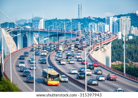 heavy traffic closeup in bridge and graceful curve shape,xiamen, China
