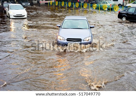 Heavy traffic on a flooded road in the city