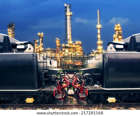 heavy truck trains in land transport and logistic against lighting of petrochemical oil industry use for land transportation and heavy container of product  - stock photo